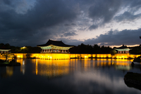 Illuminated pavilions reflecting in Anapji pond, Gyeongju, North Gyeongsang Province, South Korea