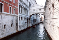 Bridge over water canal between houses, Venice, Italy