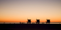 Silhouette of cabins at sunset, California, USA