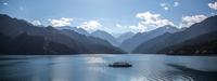 Tour boat on mountain lake, Xinjiang, China
