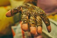 Mehndi decoration on bride hands
