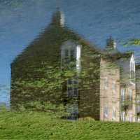 House reflecting in puddle