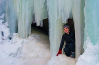Woman squatting in cave, Midland, New Brunswick, Canada