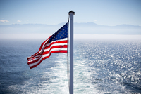 American flag and sea, Port Angeles, Washington, USA