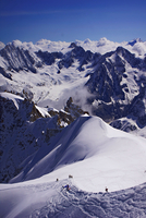 Hikers in mountains, Aiguille du Midi, Chamonix, France