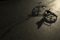 Bicycle on concrete at dusk