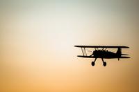 Silhouette of Vintage Stearman Biplane against sunset sky, Benton, Butlet County, Kansas, USA