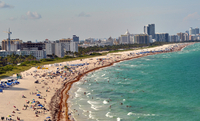 Cityscape with busy beach in foreground, Miami, Florida, USA