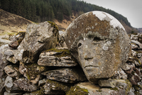Carving of human face on stone, Clatteringshaws, Dumfries and Galloway, Scotland, UK
