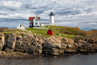 Nubble Lighthouse against cloudy sky, York Beach, Maine, USA