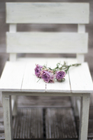 Dry roses on white chair