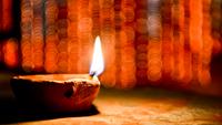 Burning diya at night, India