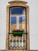 Flower box outside arched window in facade of old building, Albufeira, Algarve, Portugal