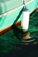 Buoy attached to boat floating on water, Murcia, Spain