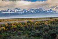 Road across Grand Teton National Park at dawn, Wyoming, USA