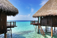 Wooden cabins against Indian Ocean, Maldives