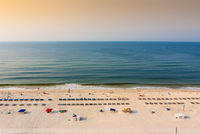 Elevated view of sandy beach with sunbeds and calm sea, Alabama, USA