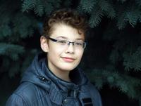 Boy against tree