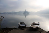 Foggy Lake Bled with fishing boats, Slovenia