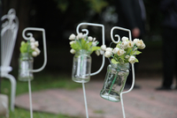 Bunches of flowers in glass jars