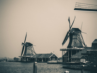 Two windmills near water, Netherlands