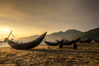 Boats on beach at sunrise, Lang Co, Hue, Vietnam