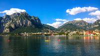 Malgrate city waterfront under mountains and cloudy sky, Malgrate, Province of Lecco, Lombardy, Italy