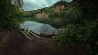 Rocks reflecting in small lake, Dornheckensee, Bonn, Germany