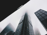Low angle view of skyscrapers in fog, New York, New York City, USA