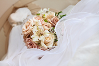 Wedding dress and bunch of flowers