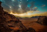 Cliffs and rock formations on Wadi Rum desert at cloudy sunset, Jordan