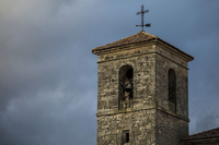 Medieval church bell tower against cloudy sky