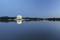 Jefferson Memorial among trees seen across water, Washington, D. C., USA