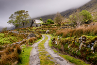 Path to old house, mountains and mist, County Kerry, Munster, Ireland