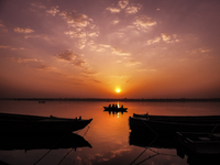 Silhouette of sailing boat on Ganges river at sunrise