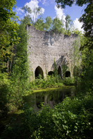 Old building in lush forest and water, Chercq, Hainaut, Belgium