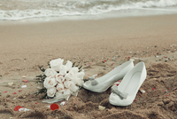 Wedding bouquet and white shoes lying on beach, Skiathos, Sporades, Greece