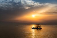 Boat on sea at dawn, Bahrain