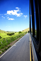 Bus trip across countryside on sunny day, Brazil