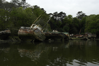 Wrecks on riverbank, Bretagne, France