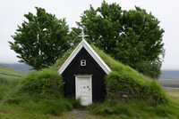 Small church with roof covered with green grass, Iceland