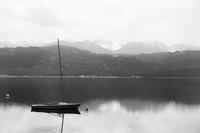 Boat on lake against mountains, Austria