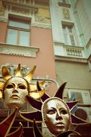 Gold carnival masks on market stall in city, Belgrade, Serbia