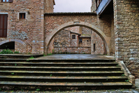 Steps by brick arch, Perugia, Italy