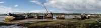 Panorama of abandoned boats on River Orwell riverbank, Ipswich, Suffolk, England, UK