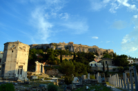 Ancient Greek ruins of Acropolis under partially clear sky, Athens, Greece