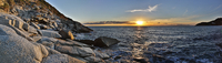 Sunset over Tyrrhenian sea with rocky coastline, Cagliari, Sardinia, Italy