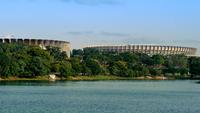 Mineirao stadium and Mineirinho sporting arena behind trees by lake, Belo Horizonte, Southeast Region, Brazil