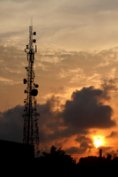 Communications tower silhouette at sunset