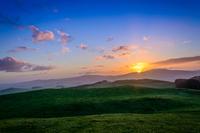 Sunset over green hills, Scotland, UK